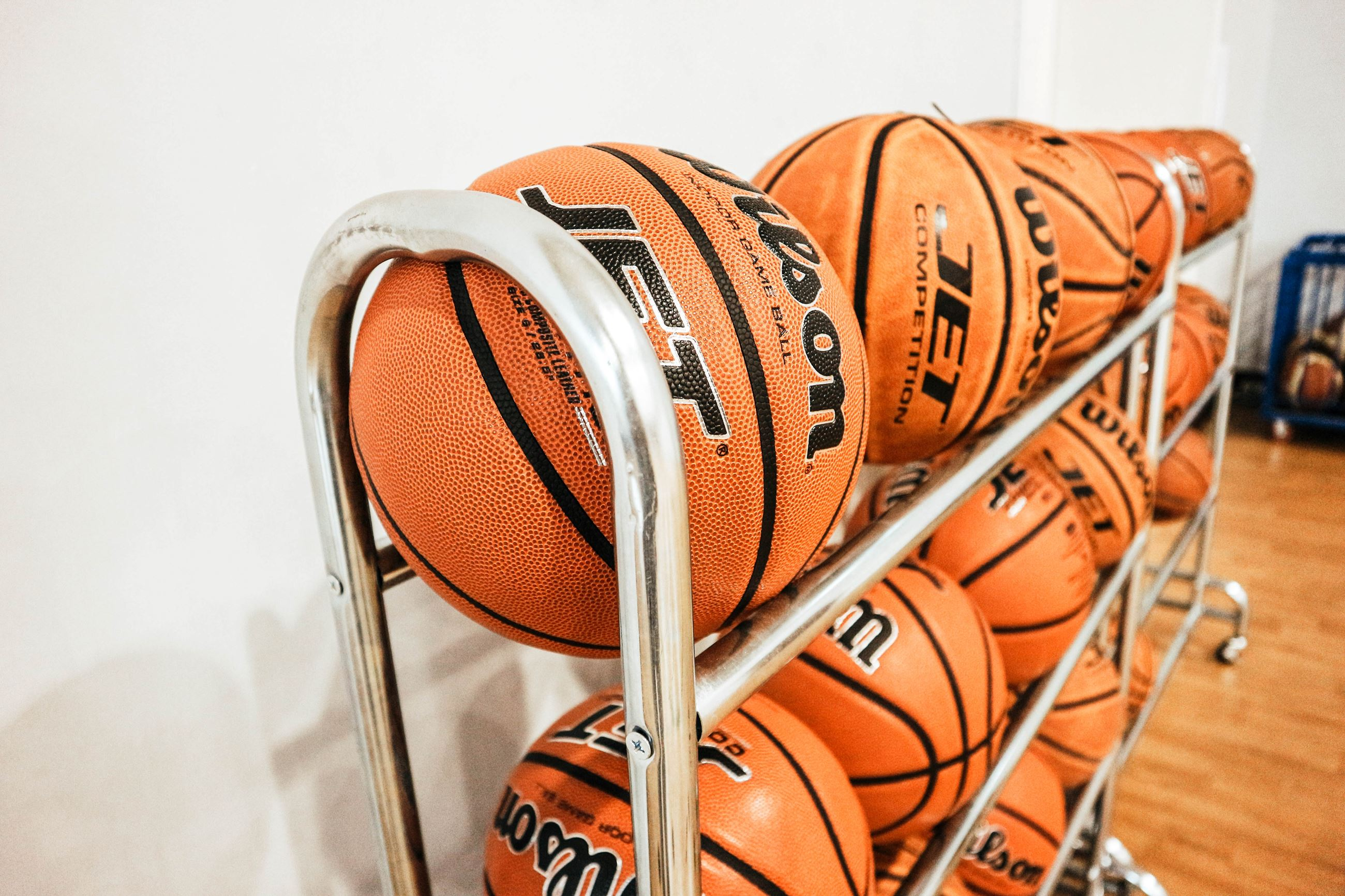 Rack of Basketballs by Finnian Hadiep on Unsplash